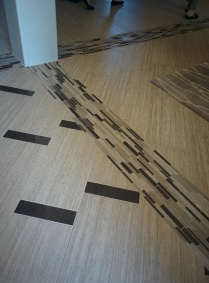 Tile delineates separation of rooms